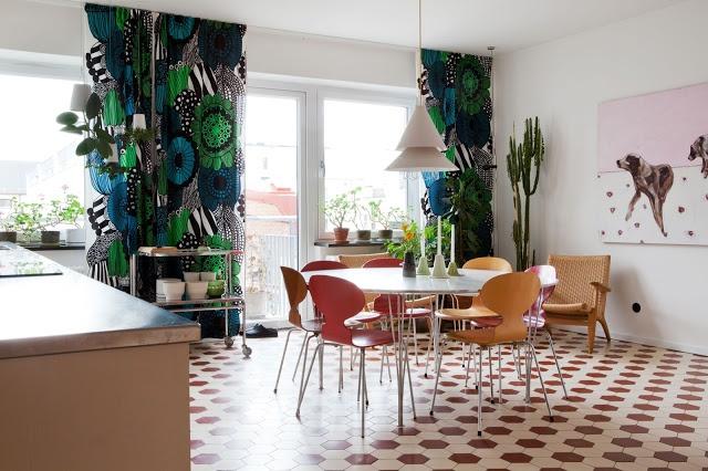 love those floor to ceiling marimekko curtains (for our livingroom?)