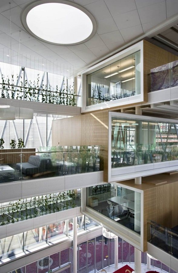 Stack the studios, one side to be double-paned glass facing different directions with interior acoustical window treatments. connect to stairs via glass bridge