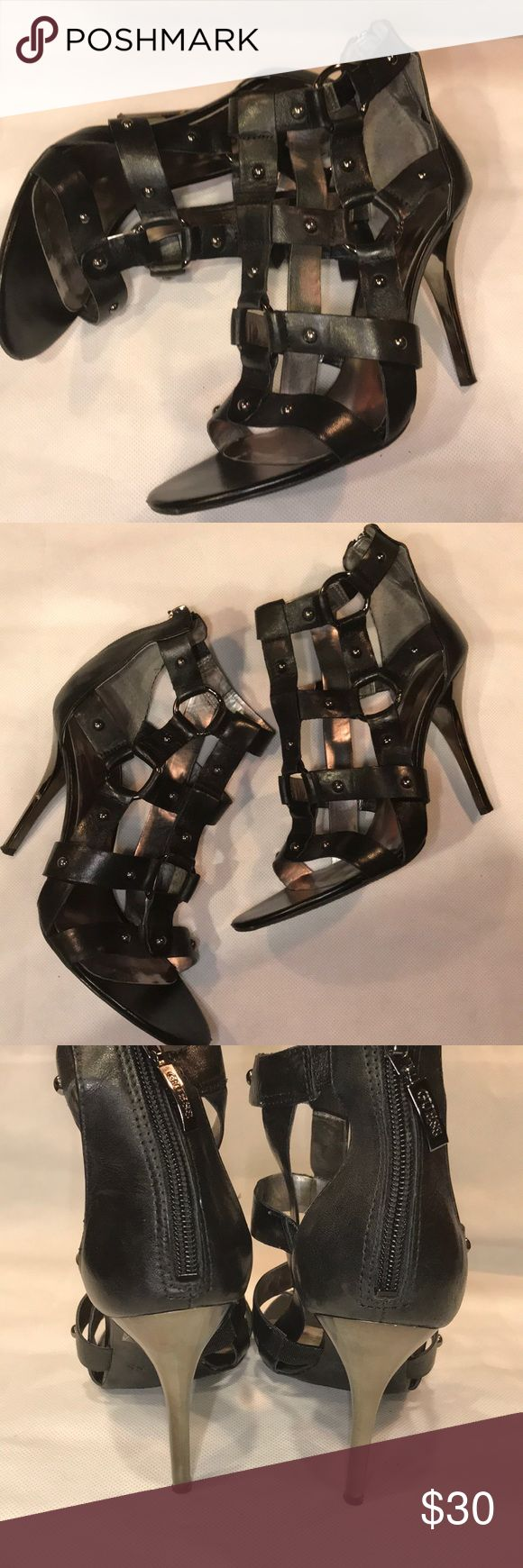 GUESS Gladiator Caged Heeled Sandals Size 8.5 GUESS Gladiator Caged Heeled Sandals Size 8.5 Leather straps have elastic and pewter rings with metal studs. Back zipper closure. Rubber sole and stiletto heels. 3.75 inch heel Guess Shoes Sandals