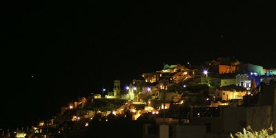 Tholos Resort Hotel Santorini - Imerovigli village by the night as seen from Firostefani