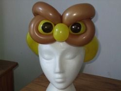 this is such a creepy looking owl balloon hat... it's watching you