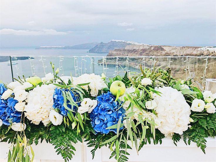 Weddings in Greece, flower garland, table set up , blue & white hydrangea , wedding decoration
