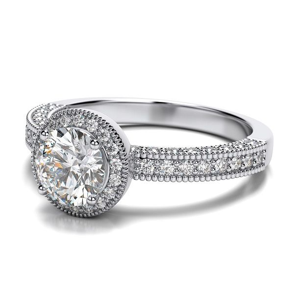 ''Odessa'' Victorian Vintage Halo Round Engagement Ring If you looking for a romantic vintage setting, this one is the perfect style.  The stones surround the round cut center diamond, cascading down inside and out, with milgrain to add that extra touch of vintage.