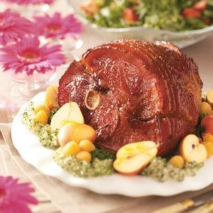 Bourbon Baked Ham Recipe -Because of its simple ingredient list, easy preparation and unbeatable flavor, this baked ham is one you'll come to rely on often. The honey-bourbon glaze not only looks lovely, but also helps to seal in the meat's juices. —Jean Adams, Waycross, Georgia