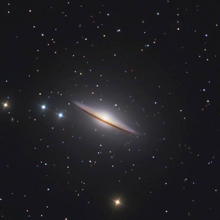 """Messier 104, una delle galassie più famose del nostro cielo, immortalata in una suggestiva ripresa realizzata da Marco Burali: """"Un totale rifacimento per questa inconfondibile galassia, M104, Sombrero Galaxy, lavoro ripartito quasi da zero e ottimizzato molto accuratamente sulle alte luci e i sottili contrasti. Il segnale di luminanza è una combinazione tra filtri a larga banda e infrarosso. full ress: http://www.osservatoriomtm.it/…/im…/180M104-L-IR-RGB2016.jpg"""