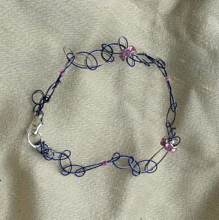 A personal favourite from my Etsy shop https://www.etsy.com/au/listing/485005363/micromacrame-wirewoven-bracelet