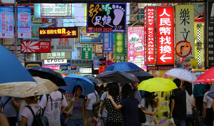 Walking in the rain - The wonderful clash colour of wet umbrellas and the…