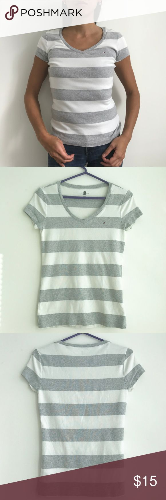 Grey & White Stripe V Neck Tee Tommy Hilfiger Size Small. 100% cotton V-neck tee with Tommy Hilfiger flag logo. 22 inches long. 15 inches from armpit to armpit laying flat. Tommy Hilfiger Tops Tees - Short Sleeve