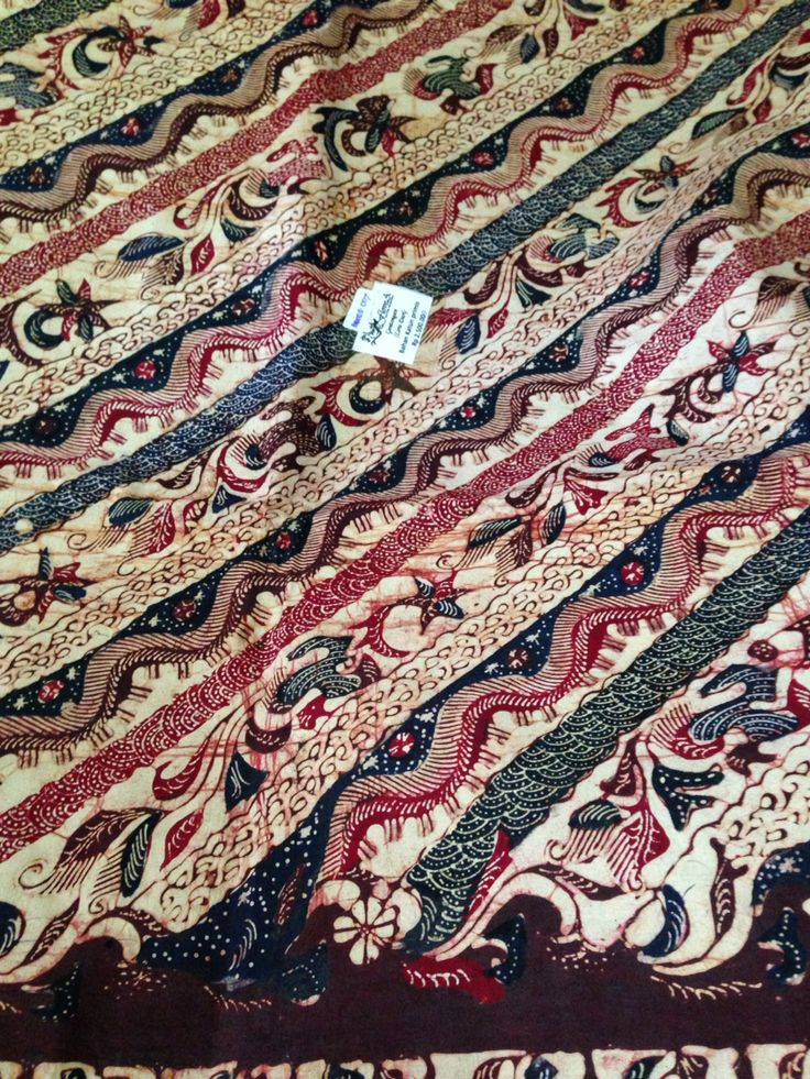 Batik gentongan from Madura. In order to get a rich color dye from natural elements such as leaves, flower or wood bark, they have to dip this cloth several weeks in a barrel or gentong in bahasa indonesia, hence the name batik gentongan. Motive name Liris Duri or Stripes of Thornes. Private collection of Arief Laksono.