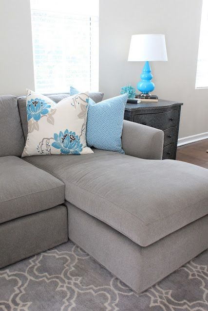Grey chaise couch with turqoise accents.  @Jennifer Milsaps L Milsaps L Milsaps L... Like the colors and that lamp matches pillow.