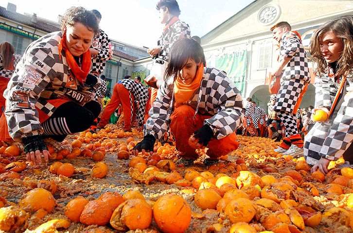 """Every February in the Italian village of Ivrea, participants of the local Carnival engage in the annual """"Orange Battle"""". The battle commemorates a popular rebellion against a local tyrant dating back to 1266 A.D."""