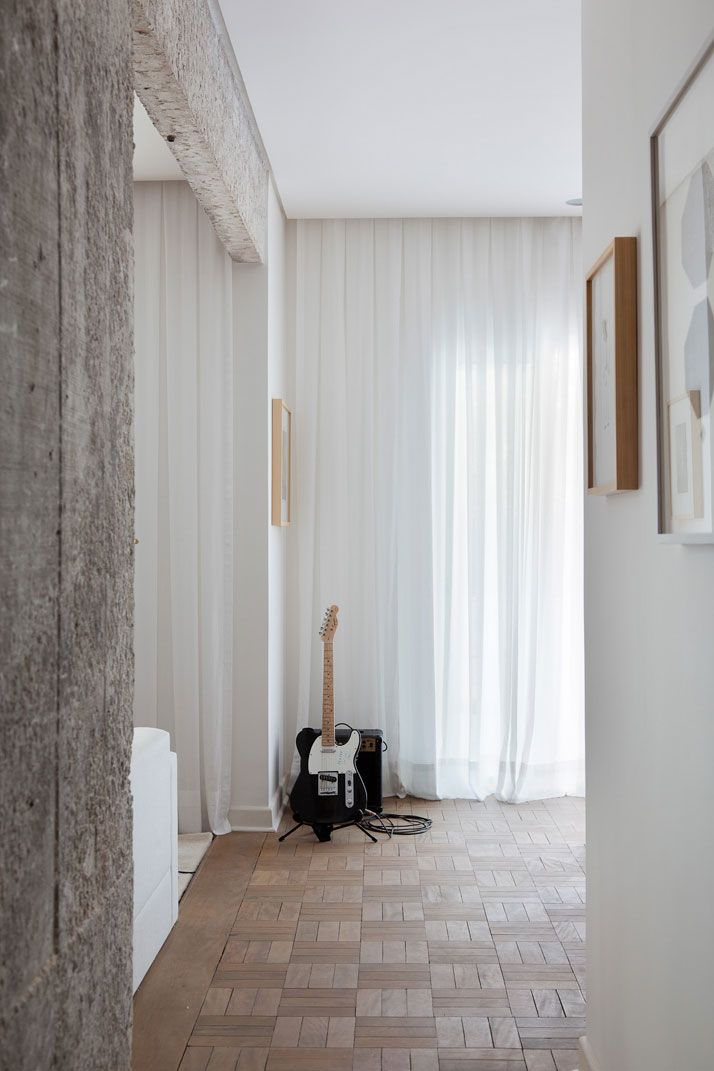Recessed curtain Full height white curtains in Midcentury apartment in Sao Paolo,