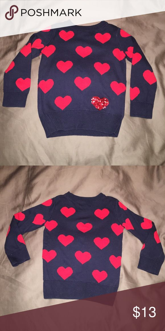 GAP KIDS Valentines Day sweater❤️ Navy blue crew neck sweater. Red ❤️cover the sweater along with one red sequin heart on the bottom left corner. Pair it with a red tutu for perfect holiday outfit. Size xs (4-5) GAP Shirts & Tops Sweaters