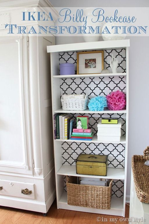 Wrap cardboard inserts to decorate the back of a bookshelf so it's easy to redo... brilliant.  ~from In My Own Style
