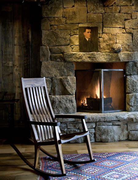 THIS is my fantasy fireplace....in the library.  Open stone hearth, probably gas logs...but a real fireplace with an open chimney. I love the rocker and the picture over the mantle. We saved a beam from our barn - would use half for the mantle in the family room and half for the mantle in the library.
