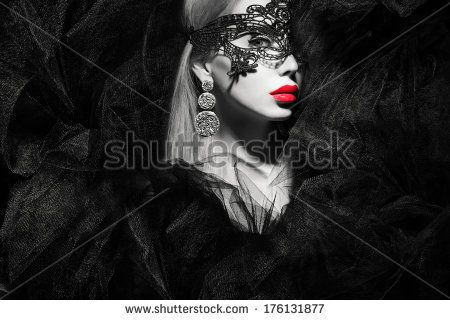 beautiful lady in mask with red lips black and white portrait