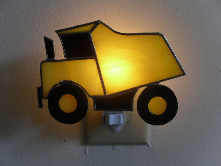 "This one of a kind hand crafted stained glass dump truck is made with copper foil, stained glass and rubber. The night light is 31/2"" x 5"" and is attached to a night light fixture. This cool night light  will light up any room day or night!  $30.00"
