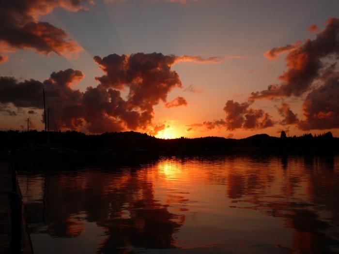 The sun sets on Gouvia, Corfu, Greece.