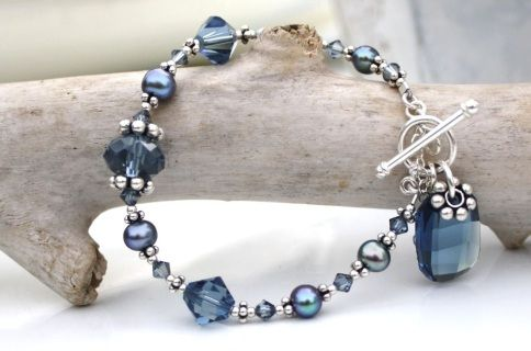 Denim Blue Swarovski  Graphic Bracelet with peacock cultured freshwater pearls with sterling silver accents and chain.