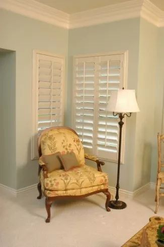 Classic shutter done in composite material with large decorative moulding.