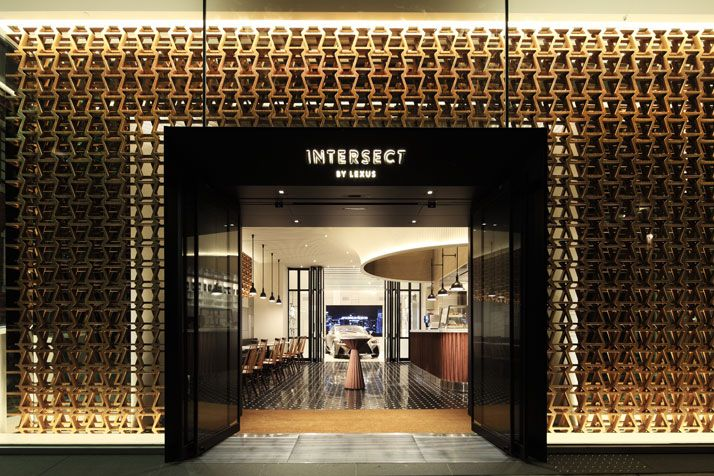 Lexus Flagship Store In Tokyo, Japan, by Wonderwall : The dedication and perfection that goes into producing each and every Lexus car is clearly reflected in the interiors of the new Intersect store. The stunning wooden perforated screen covering the facade is made of a bamboo-wood motif inspired by the trademark ''spindle grille'' of Lexus cars.