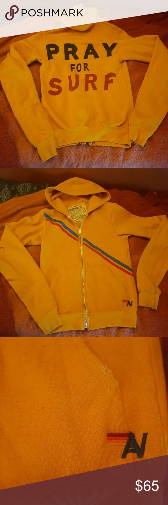 "Aviator Nation Pray For Surf Hoodie Super rad, classic, Pray For Surf hoodie by Aviator Nation. Awesome golden yellow color no longer made. Unisex size XS. Measures 15"" from pit to pit. Has some pilling, and is missing the hood string, but is in excellent shape. No stains, no holes. I love this thing, but I recently acquired one that fits better. If you have any questions, please ask! Thanks! Aviator Nation Tops Sweatshirts & Hoodies"