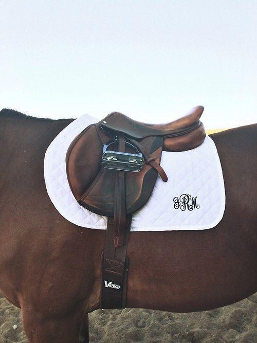 CWD saddle, curved saddle rug, monogram, add a sheepskin and bronze stirrups and we're done :)