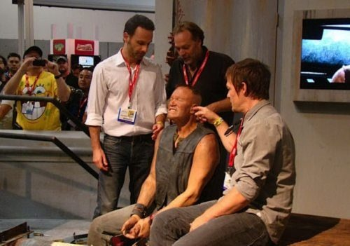 Just norman reedus messing with a wax version of merle dixon/ michael rooker