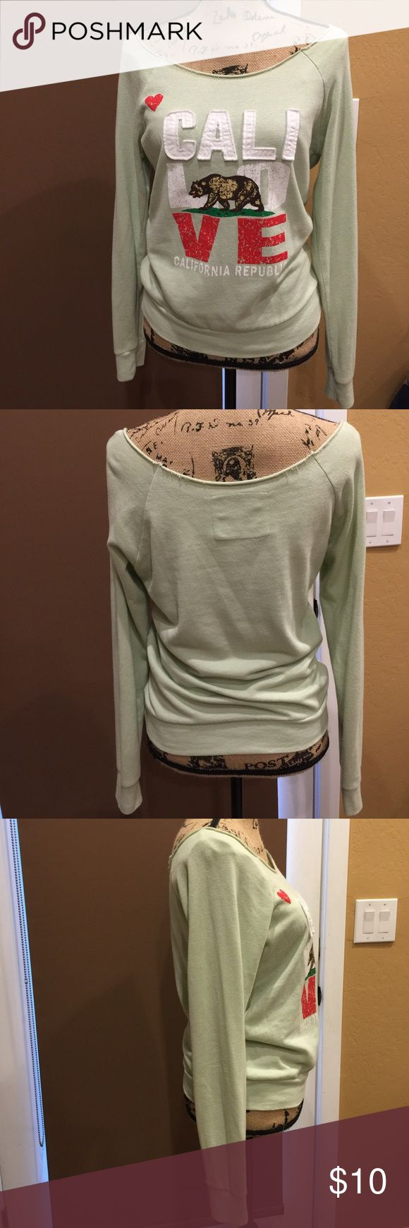 "Cali Love off the shoulder slouchy sweatshirt Cute mint green Cali Love Off the shoulder sweatshirt. This is a gently pre loved slouchy top. See pic very small blemish on sleeve & a couple of small areas ( front near letter E and on left sleeve with slight discoloration. Please make me an offer! 19"" from pit to pit. Not a thick cotton. It's super comfy too. Thank you!! Reflex Tops Sweatshirts & Hoodies"