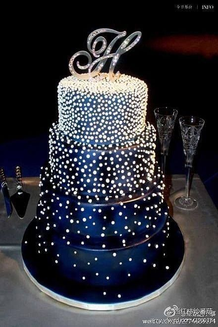 Beautiful decorated cake!!! This would be a beautiful wedding cake in any color!
