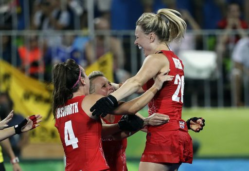 Britain tops Netherlands, wins 1st women's field hockey gold:  August 19, 2016  -    Britain's Hollie Webb, right, celebrates with her teammates after she scored the last penalty shootout goal against Netherlands, during a women's field hockey gold medal match at 2016 Summer Olympics in Rio de Janeiro, Brazil, Friday, Aug. 19, 2016. (AP Photo/Hussein Malla)