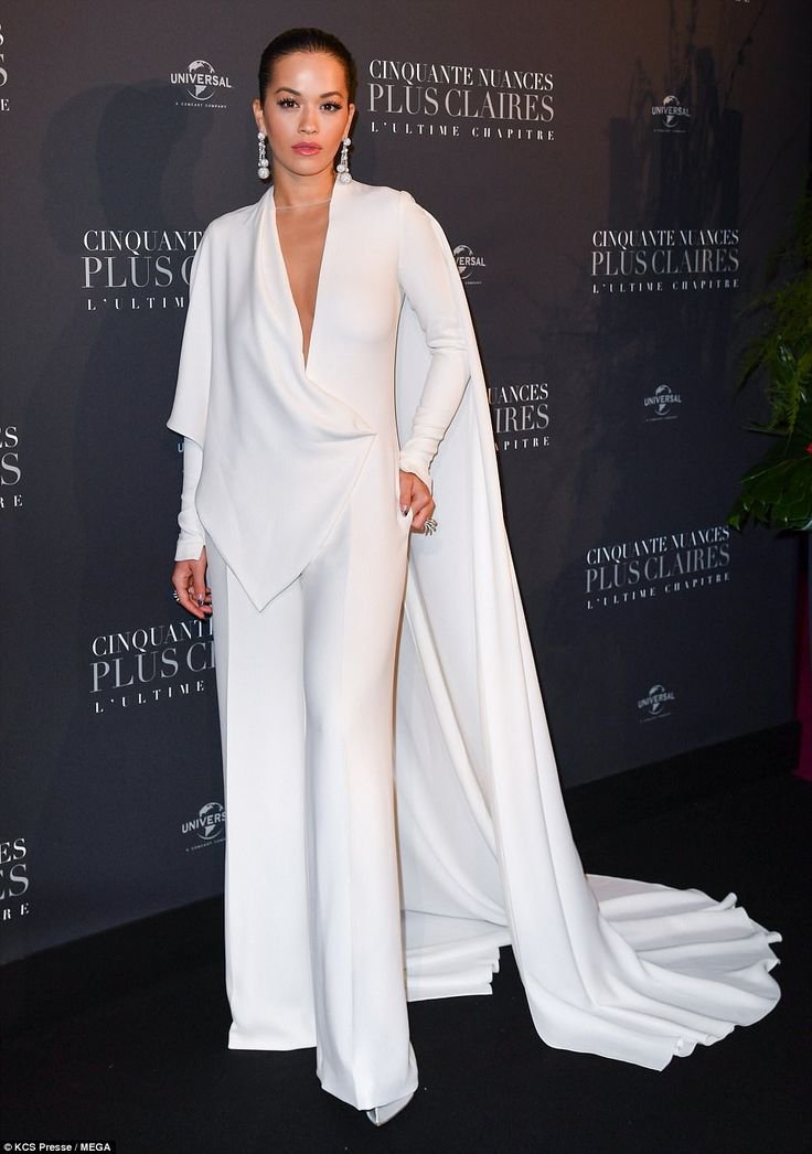 Chic:The talented singer, 27, who has recorded steamy track For You with One Direction 's Liam Payne for the film's soundtrack, looked like a fallen angel as she showed off her braless cleavage in a plunging ivory jumpsuit on the blue carpet