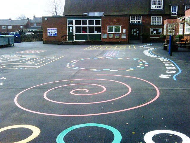 Our idea is to utilize concrete slabs throughout the town and paint play areas using stencils and/or homemade plans. Playgrounds enhanced with these designs provide opportunities to: 1) Increase children's levels of physical activity during outside play, 2) encourage development of fundamental motor skills, and 3) compliment academic learning concepts through moving. - Shannon Descant
