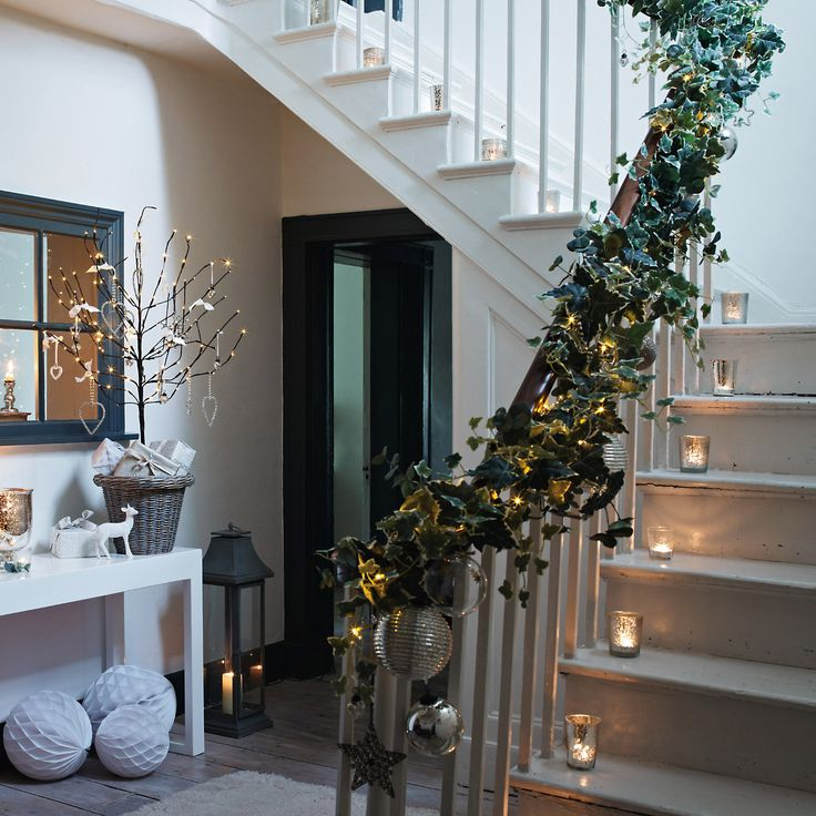 Ivy staircase with lights.