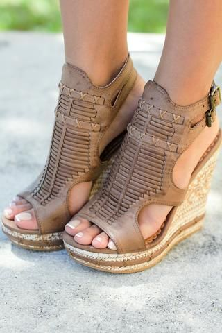 These wonderful Meta Tan Wedges are so unique, they will definitely turn heads! It is covered in the most unique & intricate details. Get your pair today from our online boutique! - Model is wearing a