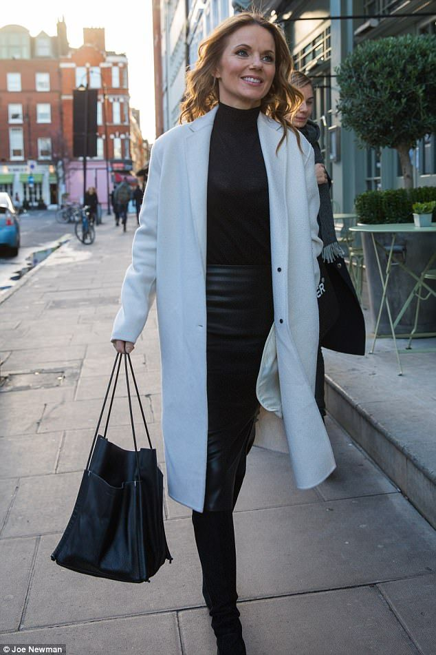 New ventures: Geri Horner put on a chic display in a demure black turtle neck and long cream coat... but spiced the look up with a leather skirt as she stepped out in London ahead of her new TV show debut