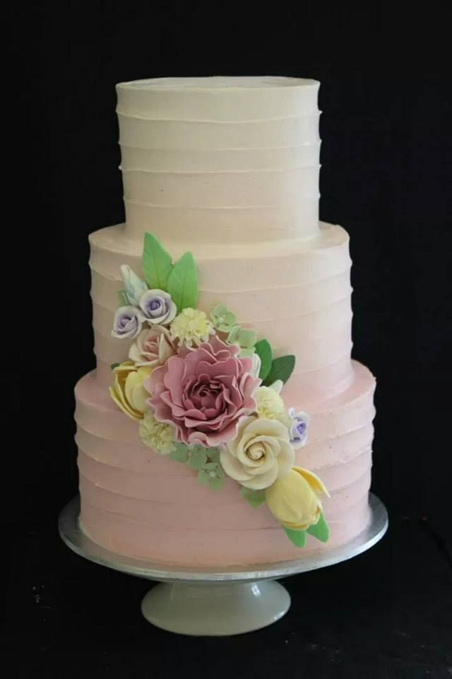 Another pink ombre with linear buttercream, and a lovely flower bunch