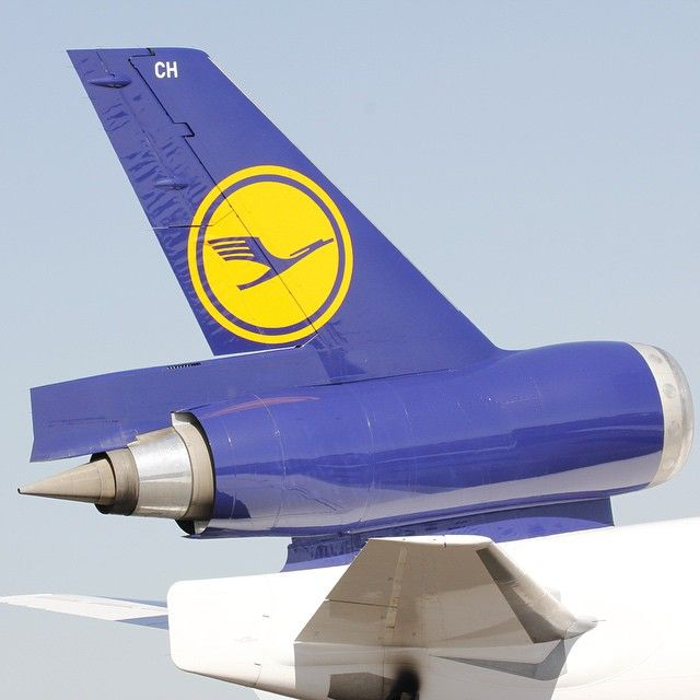 This shot of a Lufthansa Cargo MD-11 jet makes the engine's vertical support look impossibly thin