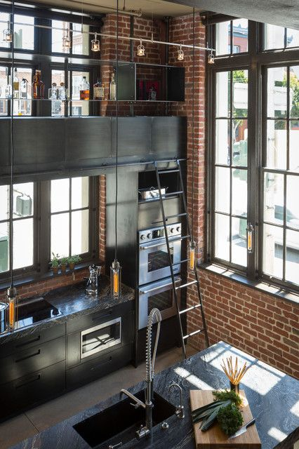 A kitchen in a warehouse remodel with that delicious combination of brick and big black trimmed windows. The ladder helps with storage. Kitchen | Home Decor
