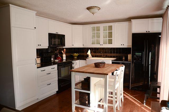 "Ikea Stenstorp Kitchen Island - wooden top works with dark countertops because all ""below"" is white."