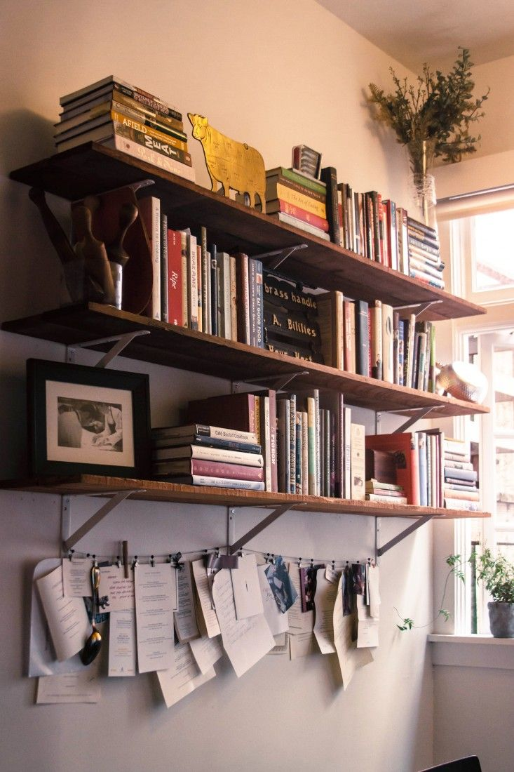 Wall of Cookbooks on Shelving in Kitchen, Remodelista