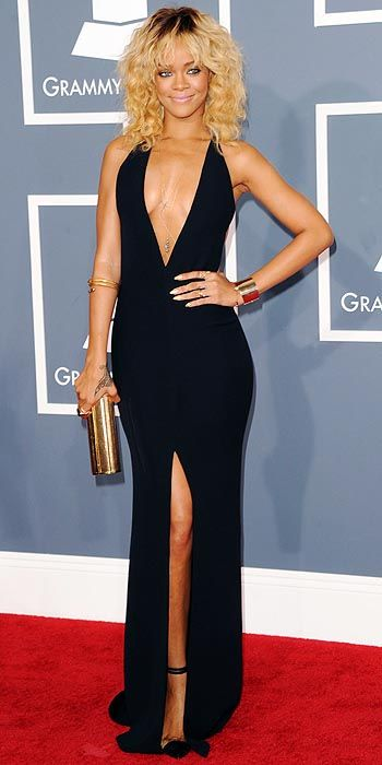 Rihanna plays it simple with a deep-cut black gown and a slit cut up to there. Are you loving her golden locks or nay?