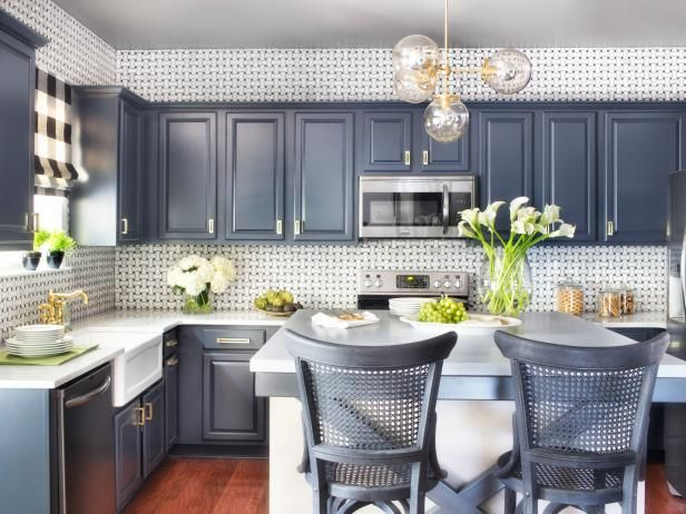 Breathe new life into dated kitchen cabinets with a fresh coat of paint. >> http://www.hgtv.com/design-blog/design/8-reasons-we-love-painted-kitchen-cabinets?soc=pinterest