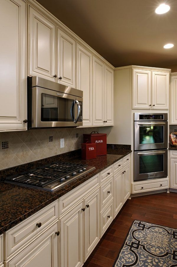 Best 25 brown granite ideas on pinterest brown granite countertops dark granite and cream - Black granite countertops with cream cabinets ...