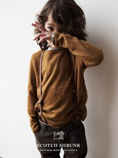 stylish little boy with suspenders