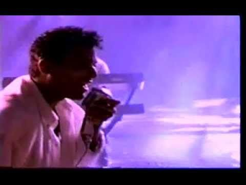 Jon Secada - Do You Believe In Us.  Love me some Secada!  Wherever you are, please come back.  I miss your sweet voice!