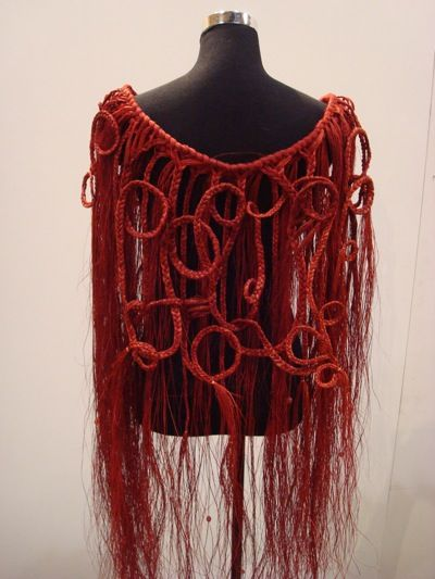 A gorgeous piece by Kiri Peen- Dark red dyed flax woven and formed into a very wearable cloak detailed with paua highlights. A one-off- perfect for a wedding, graduation or wall peice