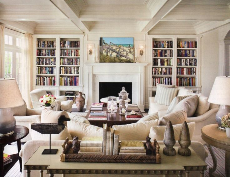 living room in the house design of alexa hampton bookshelves and ceiling to floor windows