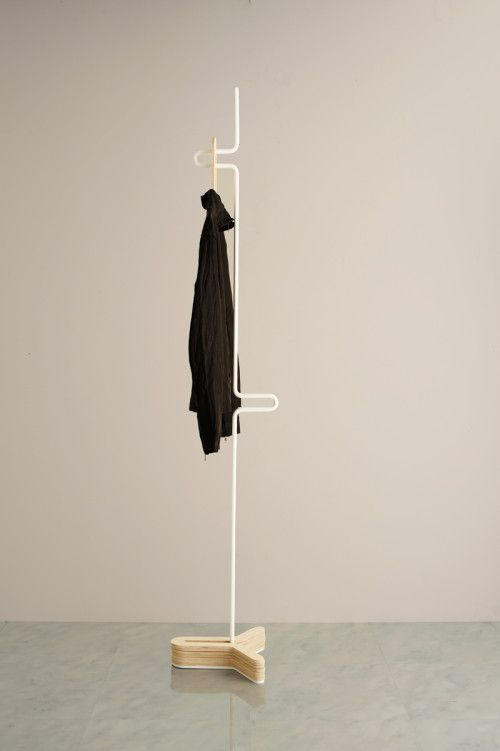 HC Hanger is a minimalist design created by Japan-based designer Yasutoshi Mifune. It is a coat hanger whose base part can store hangers by stacking them. The shape of hangers is good for hanging high-collared clothes. The base is manufactured in wood, while the rest of the hanger is bent metal. The thin white structure resembles a sculpture of sorts. (5)