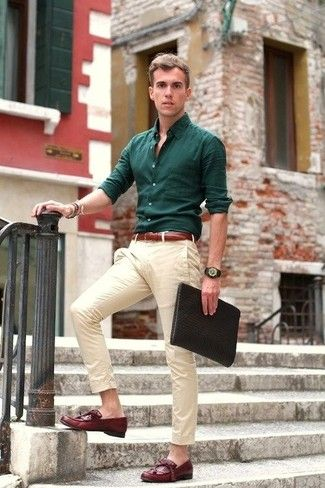 Busy days call for a simple yet stylish outfit, such as a hunter green long sleeve shirt and beige chinos. Turn your sartorial beast mode on and rock a pair of oxblood leather tassel loafers.
